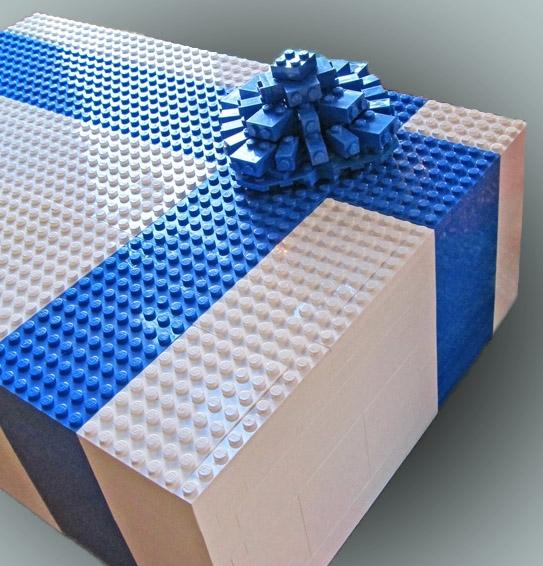 Empaqueta los libros de regalo para niños dentro de una caja de legos
